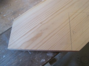 Bottom of stringer cut for rise height and baseboard.